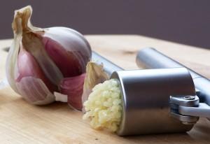 Photo of garlic and garlic press