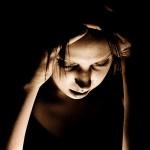 Woman suffering a migraine