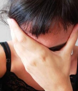 Woman displaying signs of stress