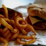Photo of a burger and curly fries
