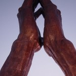 Photo of praying hands sculpture