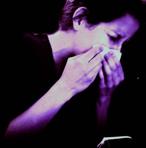 Photo of a woman sneezing