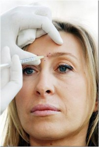 Photo of woman receiving a facial injection