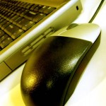 Close up photo of computer and mouse
