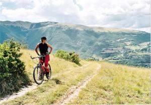 Photo of a person mountain biking