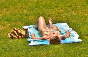 Photo of a woman lying in the sun