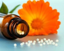 Photo of a homeopathic remedy and a flower