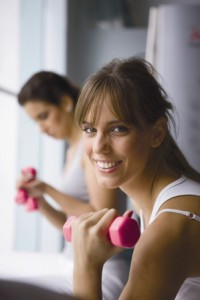 Photo of a woman with handweights