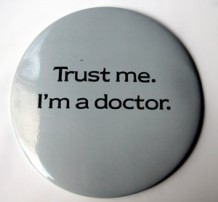 "Photo of a badge saying ""Trust me I'm a doctor"""