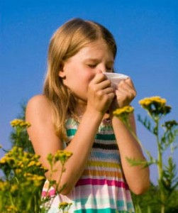 Photo of a young girl sneezing