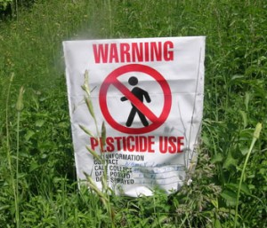 Photo of a warning sign for pesticides