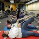 Photo of stroke victims participating in a yoga class