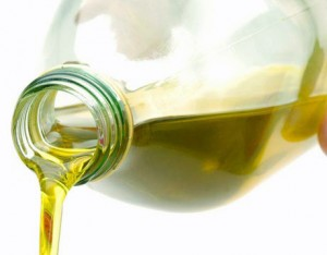 Photo of olive oil being poured from a bottle