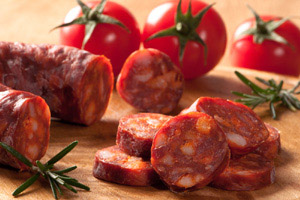 Photo of chorizo sausage on a chopping board