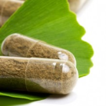 Photo of herbal capsules on a green leaf