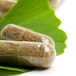 Photo of herbal capsules on a green leaf