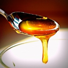 Photo of honey dripping from a spoon