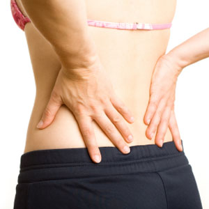 Photo of a woman with her hands on her lower back