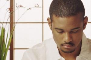 Photo of a black man meditating