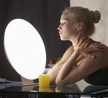 Photo of a woman sitting in front of a light box
