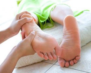 Photo of foot being massages with reflexology