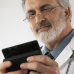 Photo of a doctor using a mobile phone to tweet