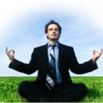 Photo of a man meditating on the grass
