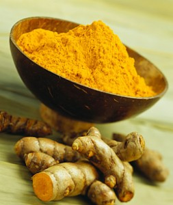 Photo of turmeric root and dried spice