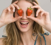 Photo of a happy woman with strawberries