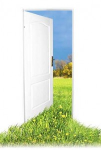 Photo of a door opened to a nature scene