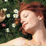 Photo of a woman sleeping in a field of flowers