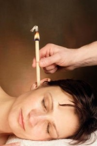 Photo of a woman receiving ear candling treatment