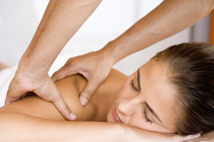 Photo of a woman having her shoulders mssaged