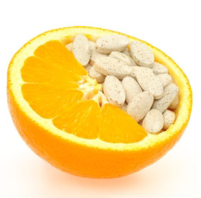 Photo of an orange and vitamin C supplements