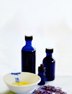 Photo of blue bottles and essential oils