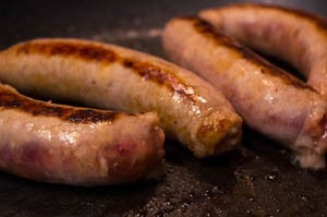 Photo of sausages in a frying pan