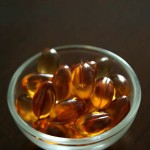 Photo of a small bowl of vitamin E capsules
