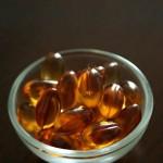 Photo of a small bowl of vitamin E capsules