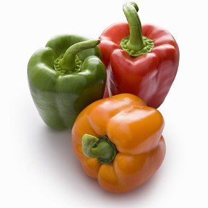 Photo of red, green and yellow peppers