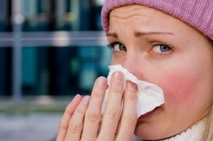 Photo of a young woman with a cold