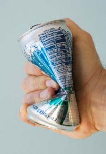Photo of a hand crushing a diet soda can