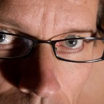 Close up photo of a man wearing glasses