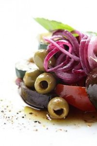 Photo of a salad of fresh Mediterranean vegetables in olive oil