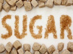 Photo of the word 'sugar' spelled out in granulated sugar