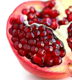 Photo of a pomegranate with seeds exposed