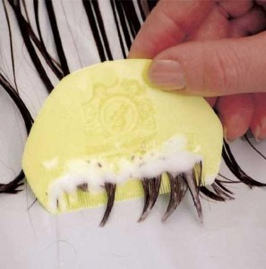 Photo of a nit comb being used on hair