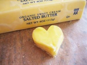 Photo of a pat of butter in the shape of a heart