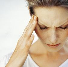 Photo of a woman with a migraine