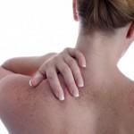 Photo of a women massaging her own neck