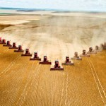 Photo of a monoculture field being harvested